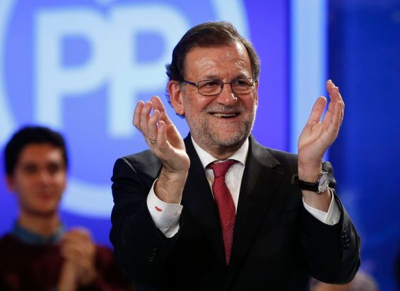 Spain's Prime Minister and People's Party (PP) leader Mariano Rajoy applauds during the final campaign rally for Spain's general election in Madrid